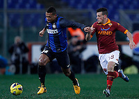 Calcio, semifinale di andata di Coppa Italia: Roma vs Inter. Roma, stadio Olimpico, 23 gennaio 2013..FC Inter midfielder Fredy Guarin, of Colombia, is chased by AS Roma midfielder Alessandro Florenzi, right, during the Italy Cup football semifinal first half match between AS Roma and FC Inter at Rome's Olympic stadium, 23 January 2013..UPDATE IMAGES PRESS/Isabella Bonotto