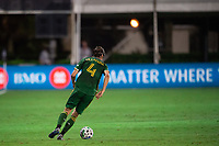 LAKE BUENA VISTA, FL - AUGUST 11: Jorge Villafana #4 of the Portland Timbers dribbles the ball during a game between Orlando City SC and Portland Timbers at ESPN Wide World of Sports on August 11, 2020 in Lake Buena Vista, Florida.