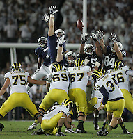 State College, PA - 10/12/2013:  Michigan PK Brendan Gibbons (34) attempts a 52 yard field goal with 2 seconds remaining in the fourth quarter.  Gibbons missed the field goal sending the game to overtime.  Penn State defeated Michigan by a score of 43-40 in four overtimes on Saturday, October 12, 2013, at Beaver Stadium.<br /> <br /> Photos by Joe Rokita / JoeRokita.com