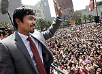 """Sept. 8, 2011, Mexico City ,Mexico ---  """"FAN FRENZY"""" ---  Superstar Manny Pacquiao waves to the reported 30,000 plus fans during his public press conference in Mexico City Thursday during the world tour to announce the third world Welterweight title mega-fight of the Pacquiao-Marquez trilogy against three-division world champion Juan Manuel Marquez.  Promoted by Top Rank, in association with MP Promotions,Marquez Boxing,Tecate and MGM Grand, Pacquiao vs Marquez III will take place, Saturday, Nov. 12 at the MGM Grand in Las Vegas and be produced and distributed by HBO Pay Per View.   --- Photo Credit : Chris Farina - Top Rank  (no other credit allowed)  copyright 2011"""