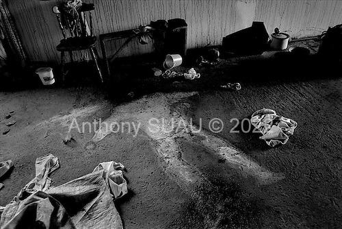 Orize, Kosovo  <br /> 1999<br /> <br /> The ghostly outline of an elderly man, who was executed by Serbian military with a machine gun, lies on the floor where he fell after which the Serbian gunmen burnt the room. A neighbor witnessed the execution.