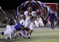 Springdale Bulldogs Senior Gilberto Dominguez (22) is brought down by Rogers Mountaineers Sophomore Kahleb Braxton (45) Friday, October 16, 2020, at Whitey Smith Stadium, Rogers, Arkansas (Special to NWA Democrat-Gazette/Brent Soule)