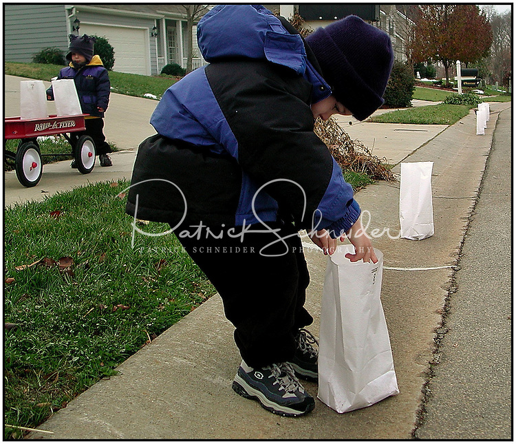 A family prepares to set out luminaries. Photo taken near Charlotte, NC. Model released image.