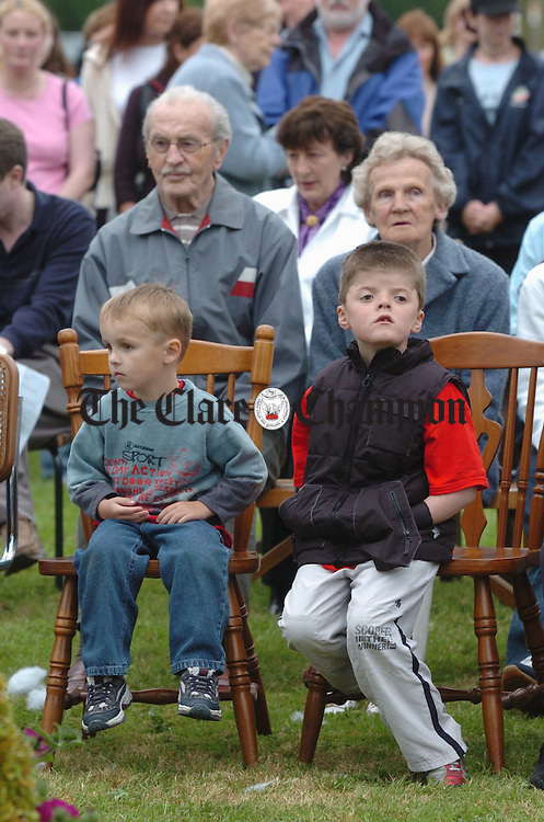 Elderly and young alilke attended the open air mass on the green at Corrovorrin, Ennis recently. Photograph by John Kelly.