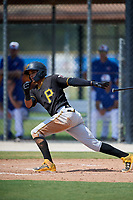 Pittsburgh Pirates shortstop Adrian Valerio (29) follows through on a swing during a Florida Instructional League game against the Toronto Blue Jays on September 20, 2018 at the Englebert Complex in Dunedin, Florida.  (Mike Janes/Four Seam Images)
