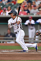 Tennessee Smokies center fielder Jae-Hoon Ha #3 follows through on his swing against the Jacksonville Suns at Smokies Park July 10, 2014 in Kodak, Tennessee. The Suns defeated the Smokies 6-5. (Tony Farlow/Four Seam Images)