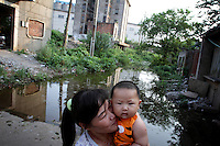 Floods in the streets of Yueyang City next to Dongting Lake, Hunan Province. Dongting Lake has decreased in size in recent decades as a result of land reclamation and damming of the Yangtze. Summer flooding pushes water into the city. China. 2010