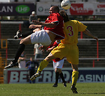Leigh RMI 0, FC United of Manchester 0, 16/07/2005. Hilton Park, pre-season friendly. Visiting player Jonathan Mitten (in red) challenges for the ball. FC United of Manchester were established by dissident Manchester United supporters in the wake of the Malcolm Glazer takeover of their club. They were admitted to the North West Counties League prior to the 2005-06. Photo by Colin McPherson.