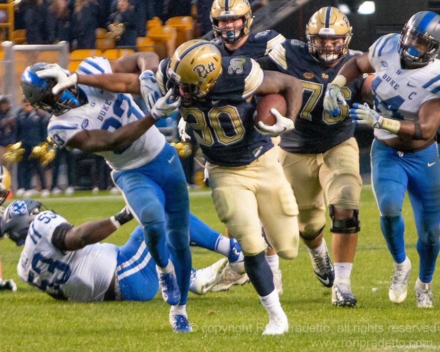 Pitt running back Qadree Ollison stiffarms Duke defensive back Lummie Young IV.The Pitt Panthers football team defeated the Duke Blue Devils 54-45 on November 10, 2018 at Heinz Field, Pittsburgh, Pennsylvania.