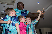 "Wycombe Wanderers new signing, Adebayo Akinfenwa, aka ""The Beast"", takes a selfie with young fans as he is unveiled during the 2016/17 Kit Launch of Wycombe Wanderers to the public at Adams Park, High Wycombe, England on 10 July 2016. Photo by David Horn."