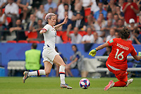 PARIS, FRANCE - JUNE 28: Megan Rapinoe #15, Sarah Bouhaddi #16 prior to a 2019 FIFA Women's World Cup France quarter-final match between France and the United States at Parc des Princes on June 28, 2019 in Paris, France.