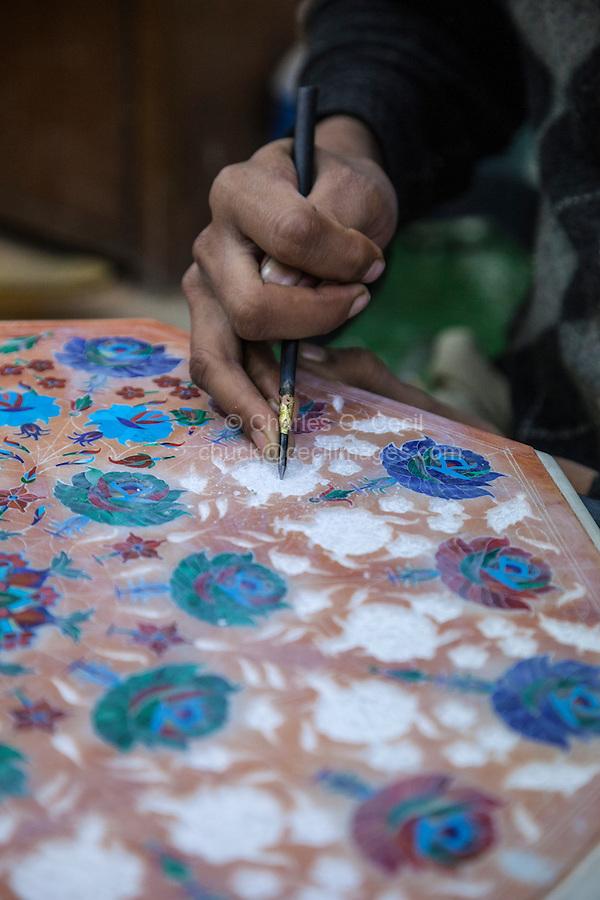 Agra, India.  Craftsman Preparing Table Top to Receive Semi-precious Inlaid Stone.