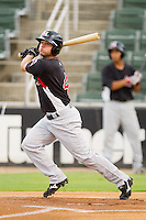 Travis Adair #4 of the Hickory Crawdads follows through on his swing against the Kannapolis Intimidators at Fieldcrest Cannon Stadium August 17, 2010, in Kannapolis, North Carolina.  Photo by Brian Westerholt / Four Seam Images