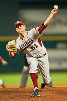 Relief pitcher Cade Lynch #51 of the Arkansas Razorbacks delivers a pitch to the plate against the Houston Cougars at Minute Maid Park on March 3, 2012 in Houston, Texas.  The Cougars defeated the Razorbacks 4-1.  Brian Westerholt / Four Seam Images