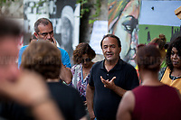 """(From L to R) De Magistris (Naples), Lucano (Riace).<br /> <br /> Riace (Calabria, Italy), 04/08/2018. Visiting Riace for the third day of the """"Riace in Festival"""", 'Festival delle Migrazioni e delle Culture Locali' (Festival of Migration and Local Cultures). Attending the festival, amongst others, were the Mayor of Napoli Luigi De Magistris and the Mayor of Barcelona Ada Colau, debating with the Mayor of Riace, Domenico 'Mimmo' Lucano, about the so called """"migration crisis"""", as well as the now famous """"Modello Riace"""" (The Riace Model: how to welcome and work with Migrants to invest in building a future together). Other speakers included: Tiziana Barillà, Journalist at """"il Salto"""" (1) and Author of the book """"Mimi Capatosta. Mimmo Lucano e il modello Riace"""" (2), Magistrates Riccardo De Vito and Emilio Sirianni (in turn President and Member of Magistratura Democratica). Chair of the event was Ilaria Bonaccorsi, Historian & Journalist at """"il Salto"""".<br /> From the Festival website: """"RIACE in FESTIVAL, is an event born in the wake of the policy of reception and resettlement of refugees and asylum seekers that the city administration of the """"Riace Bronzes'"""" town has been implementing for years. [...] The festival aims to be a concrete initiative that, through the universal language of cinema and the arts, promotes the exchange and mutual knowledge to counteract forms of closure and racism, drawing attention to the innovative path that the municipal administration of Riace has started by combining the reception of migrants with the revival of its territory and giving the image of an unpublished Calabria, different from that of the black chronicle>>.<br /> Riace is a small village in the province of Reggio Calabria. It's famous because on the 16 August 1972...<br /> <br /> (For the full caption read the ARTICLE at the the beginning of this story)"""