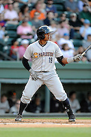 Catcher Isaias Tejeda (19) of the Charleston RiverDogs bats in a game against the Greenville Drive on Sunday, May 24, 2015, at Fluor Field at the West End in Greenville, South Carolina. Charleston won 3-2. (Tom Priddy/Four Seam Images)