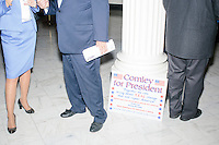 A campaign sign for outsider Republican presidential candidate Stephen Comley lays against a column as real estate mogul and Republican presidential candidate Donald Trump arrives at the New Hampshire State House to officially file his candidacy in the New Hampshire primary in Concord, New Hampshire.
