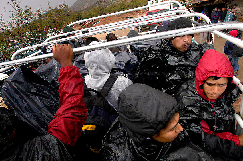 """A bus packed with as much as thirty immigrants leaves ?La Ladrillera?, the last pocket of civilization where supplies, water and a last minute """"coyote"""" or guide can be purchased before they make their way to the many entry points along to the Arizona / Mexico border."""