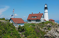 Portland Maine lighthouse famous Portland Head Light white with house on cliff