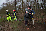 the last protestors to be  removed from the trees  at the decoy pond Combe Haven . Bexhill - Hastings Bypass..There's a huge security prescence - amidst a muddy swamp..Around 100  police and  turned up and security .  15 people remain in the trees. East Sussex countly council pushing for the road to  be built   refused to allow food and  medicine into the trees.  The  tree protesters sat out  3 nights of gales and  rain