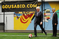 Former President Bill Clinton kicks a soccer ball as he enters the field for his press conference prior to a press conference announcing former President Bill Clinton as the honorary chairman of the USA Bid Committee to host the FIFIA World Cup in 2018 or 2022 at the FC Harlem Field in Harlem, NY, on May 17, 2010.
