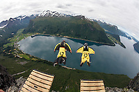 Andreas Barkhall (left) race Hans Holmefjord, both wearing wingsuits. World Base Race, the first event where BASE jumpers compete to be the fastest flying down from a mountain, before deploying their parachute. The the contestants jump from a mountain in the fjord Innfjorden in Western Norway, two jumpers race each other to the finish line 750 meters horizontally from the mountain.
