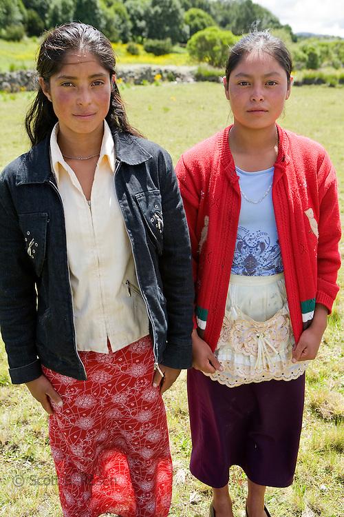 Two teenage girls posing, San Nicolas, Western Highlands, Guatemala