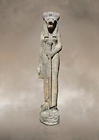 "Ancient Egyptian statue of goddess Sekhmet, grandodiorite, New Kingdom, 18th & 20thDynasty (1390-1150 BC), Thebes. Egyptian Museum, Turin. Grey Background.<br /> <br /> Sekhmet, ""the Powerful One"" was a fearsome goddess symbolised by her lioness head. Daughter of the sun she personifies the disk of the world during the day. Sekhmet is the angry manifestation of Hathor inflicting the scourges of summer heat, famine and illness which is why the goddess needed to be exorcised every day. Drovetti Collection. C 263"