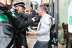 © Joel Goodman - 07973 332324 . 03/09/2011 . London , UK . A man is detained as the English Defence League hold a rally in Aldgate, near Tower Hamlets in East London. The group had intended to march however the Home Secretary banned all marches in the area. Photo credit : Joel Goodman