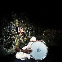 A drummer in the Kathputli Colony plays a traditional Punjabi Bangra song. The Kathputli Colony, located in northwest Delhi, is inhabited by approximately 2,000 performing artists, practicing traditional art forms such as marionette puppetry, juggling, magic, acrobatics, dance and music. Many have travelled all over the world showcasing their abilities, but they still choose to remain living in this slum, which is one of the most impoverished in the city.