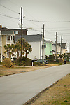 Surf city, vacation homes view along street.