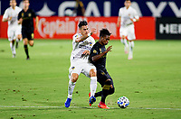 CARSON, CA - SEPTEMBER 06: Cristian Pavon #10 of the Los Angeles Galaxy battles with Latif Blessing #7 of LAFC for a ball during a game between Los Angeles FC and Los Angeles Galaxy at Dignity Health Sports Park on September 06, 2020 in Carson, California.
