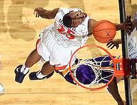 Jan. 2, 2011; Charlottesville, VA, USA; Virginia Cavaliers forward Akil Mitchell (25) defends LSU Tigers guard Andre Stringer (10) on a shot  during the game at the John Paul Jones Arena. Virginia won 64-50. Mandatory Credit: Andrew Shurtleff-
