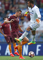 Calcio, Serie A: Roma vs Sampdoria. Roma, stadio Olimpico, 11 settembre 2016.<br /> Roma's Edin Dzeko, left, prepares to kick to score during the Italian Serie A football match between Roma and Sampdoria at Rome's Olympic stadium, 11 September 2016. Roma won 3-2.<br /> UPDATE IMAGES PRESS/Isabella Bonotto