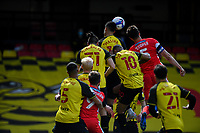 24th April 2021; Vicarage Road, Watford, Hertfordshire, England; English Football League Championship Football, Watford versus Millwall; Adam Masina of Watford clears with a header from a Millwall cross.