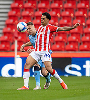 21st April 2021; Bet365 Stadium, Stoke, Staffordshire, England; English Football League Championship Football, Stoke City versus Coventry; Christian Norton of Stoke City under pressure from Leo Ostigard of Coventry City
