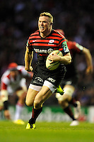 Chris Ashton of Saracens splits the Ulster defence to score a try during the Heineken Cup quarter final match between Saracens and Ulster Rugby at Twickenham Stadium on Saturday 6th April 2013 (Photo by Rob Munro)