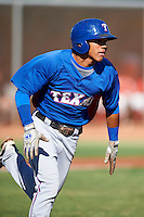 Texas Rangers minor league infielder Luis Marte #2 during an instructional league game against a Korean All-Star team at the Surprise Stadium Complex on October 13, 2012 in Surprise, Arizona.  (Mike Janes/Four Seam Images)