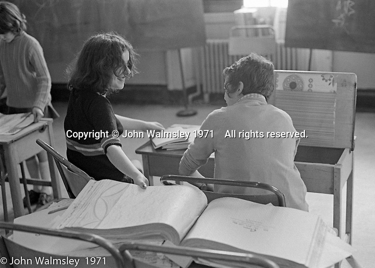 In the foreground, the wallpaper catalogue used to decorate the room and desk lids, Scotland Road Free School, Liverpool  1971.  Also known as the Scotland Road or Scottie Road Free School it was founded and run by two teachers, John Ord and Bill Murphy (if I've got these names wrong, please tell me!) who worked with truanting kids and provided somewhere to go and things to do.  They begged and borrowed an old building, desks, books and an old ambulance for trips.
