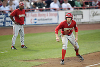 Harrisburg Senators outfielder Bryce Harper #34 leads off third with manager Tony Beasley in the background during a game against the Erie SeaWolves at Jerry Uht Park on August 6, 2011 in Erie, Pennsylvania.  Harrisburg defeated Erie 10-6.  (Mike Janes/Four Seam Images)