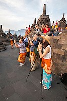 Borobudur, Java, Indonesia. Tourists at top of Temple Photographing  Morning Sunrise.