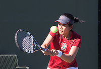 STANFORD, CA - MARCH 1, 2015--Stanford women's tennis player Ellen Tsay return the ball back to a  CAL Berkley player during Sunday's match at  at the Taube Family Tennis Stadium.