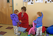 MR/ Schenectady, New York.Schenectady Day Nursery: private, non-profit daycare.Toddler class / Single working mom picks up daughters (30 months,twins) at daycare..MR:Rob5, Rob6, Rob7.PN#: 25745      FC#:21783-00111.scan from slide.© Ellen B. Senisi