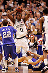 Connecticut center Hilton Armstrong (11) makes a pass over Kentucky guard Patrick Sparks (22).  Connecticut defeated Kentucky 87-83 in the second round of the NCAA Tournament  at the Wachovia Center in Philadelphia, Pennsylvania on March 19, 2006.