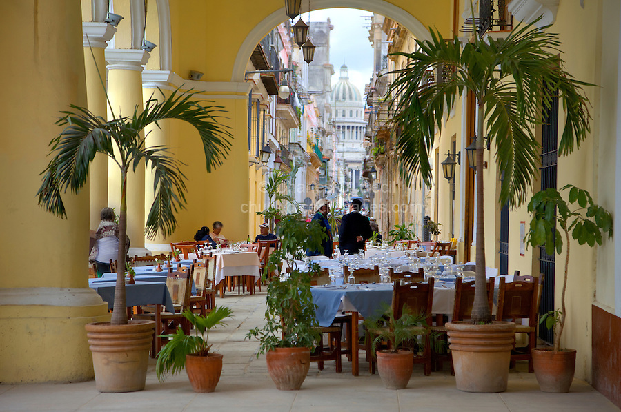 Cuba, Havana.  Outdoor Restaurant at the Plaza Vieja.  Capitol Building in the distance.
