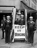 Bell ringers on Seattle, Wash., streets during 4th Liberty Loan.  Bells were afterwards muffled, as a reproach, subscriptions coming too slow.  1918.  Webster & Stevens.  (War Dept.)<br />Exact Date Shot Unknown<br />NARA FILE #:  165-WW-243-108<br />WAR & CONFLICT BOOK #:  513