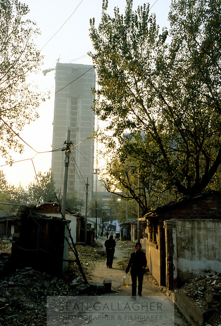 CHINA. Beijing. The ruins of an old hutong (traditional home) in the central Dongzhimen district, destroyed to make may for new developments aimed at modernising the city for the 2008 Summer Olympics. 2005
