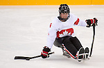 Sochi, RUSSIA - Mar 11 2014 -  Derek Whitson looks to make a pass as Canada takes on Czech Republic in Sledge Hockey at the 2014 Paralympic Winter Games in Sochi, Russia.  (Photo: Matthew Murnaghan/Canadian Paralympic Committee)