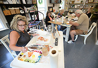 Artist Beth Woessner paints Thursday, Sept. 9, 2021, while teaching a class at her home studio in Tontitown. Woessner's students were learning to paint a portrait of their pet in watercolor. Visit nwaonline.com/210910Daily/ for today's photo gallery.<br /> (NWA Democrat-Gazette/Andy Shupe)