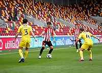 6th September 2020; Brentford Community Stadium, London, England; English Football League Cup, Carabao Cup, Football, Brentford FC versus Wycombe Wanderers; Emiliano Marcondes of Brentford is marked by Joe Jacobson and Dominic Gape of Wycombe Wanderers.